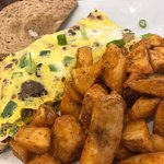 Carolinian Omellette with home fries. YUM!