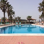 Lovely clean pool on the beach  with plenty of padded sun loungers & parasols also a pool bar.
