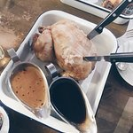 Whole roast chicken with pepper sauce and southern style gravy