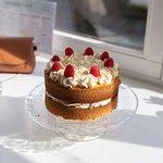 Home made cake, white chocolate and raspberry cake.