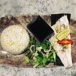Steamed Seabass served with a side of Fried Rice and Salad.