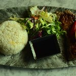 Sirloin Steak with spicy mint sauce dressing served with fried rice.