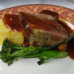 Herb crusted lamb, braised shoulder and boulangere potatoes with ratatouille, tenderstem broccol