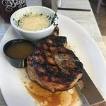 Grilled porkchop with creamed spinach