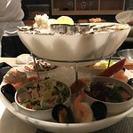 Seafood tower for two- crab and shrimp salads below, oysters, shrimp, mussels and lobster with i