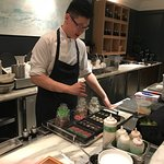 Chef Johnny as assistant Jimmy at work doing their magic with seafood and showing a dessert
