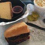 Brisket sandwich, cheesecake, and creamed corn