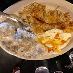 This is my breakfast of biscuits & gravy, eggs, and hash browns.