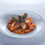 Gulf Shrimp and Seared Scallops atop roasted garlic rose tossed shell pasta