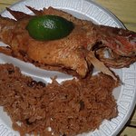 Fried snapper with 'peas' (beans( and rice