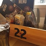 Table rack with number, menus, and sauces.