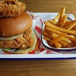 Double chicken burger with calamari and chips.