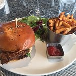Incredible fried chicken sandwich - it has bacon maple glaze and arugula (and pickles)