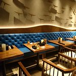 Restaurant interior with soft lighting adds to the warm ambiance for the place