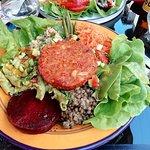 Vegan patty with pasta, lentils, bulgur wheat, beetroot, lettuce, tomato, carrot, green beans, e