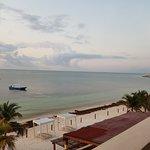 From third floor terrace overlooking restaurant and beach