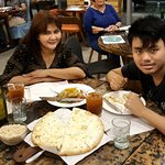Enjoying Dova's pizza