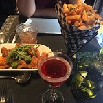 Calamari Fritti and Truffle Frites, a Negroni in the foreground and a Manhattan