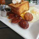 French Toast with Coconut Pudding, toasted mac nuts, Portuguese Sausage and eggs