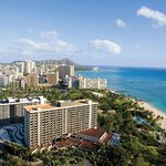 There are two buildings with Waikiki Beach in front and Diamond Head in the distance.