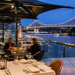 Balcony dining with views of Brisbane River