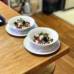 Lemon Yogurt with granola, pomegranate seeds, and a drizzle of our home made maple syrup.