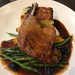 Duck Confit with Black Cherry Sauce.