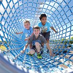 Children in tunnel at Outdoor Play Plaza