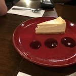 New York baked cheesecake with a raspberry coulis
