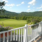 Hogan's Pub serves lunch on the deck overlooking Lincoln Peak and the 18th green.