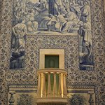 Beautiful azulejos (Portuguese painted tiles) decorating the walls.