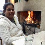 Cold traveller beside warm fire