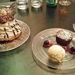 Dessert of a Warm chocolate mœlleux, sour cherries, vanilla ice cream, and a Big chou
