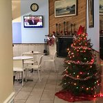 Breakfast area with TV and holiday decor