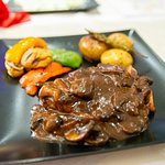 Beef fillet with mushrooms, potatoes and a variety of peppers