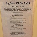 A reward poster (in the mail car train carriage)