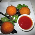 Ricecini (stuffed rice balls w/ marinara sauce)