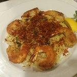 Fried shrimps over pasta