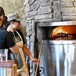 Wood oven pizza stove with staff.