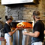 Wood fired pizza oven with staff.