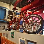 the interior decor... motorcycle and car hanging from wall!