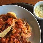Shrimp Capelli Bistro ( fresh shrimp with mushrooms, tomato, basil, garlic and lime)