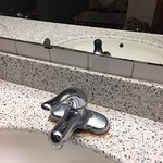 Rust around faucet. Mirror finish coming off...come on folks..