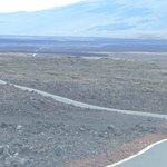 Mauna Loa Observatory Road shooting toward Saddle Road. Mauna Kea in the background.