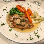 A delicious chicken piccata w/perfectly done vegetables.