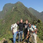 With Kato and his co-guide Nestor on Mount Sabyinyo