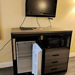 Very small TV, fridge, microwave, but no coffeemaker.