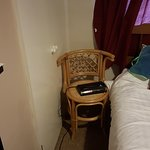 Only one chair in the room and it was for the clock radio, so no room to open the cupboard.