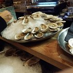Plump and fresh oysters on the half shell with a myriad of sauces