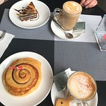 Cinnamon roll, layer cake and coffee